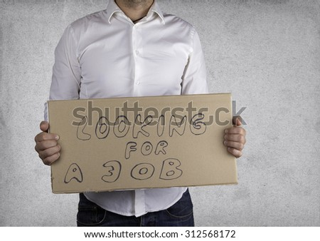 Businessman holds the inscription - Looking for a job