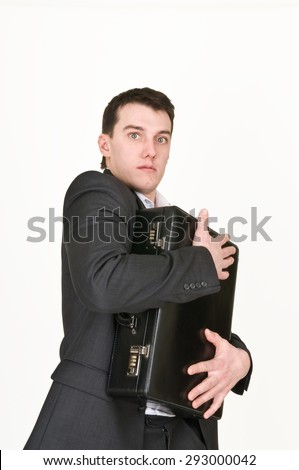Businessman hugging case
