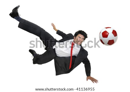 Businessman in a acrobatic pose kicking a soccer ball  isolated in white - stock photo