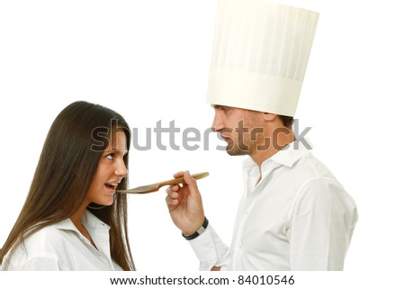 Businessman in a chef's cap with his colleague isolated  on white background