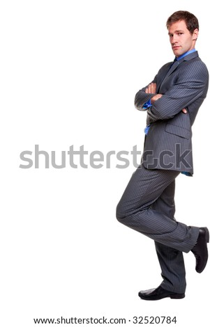 Businessman in a pinstripe suit leaning with his arms folded, looking at camera, isolated on a white background. - stock photo