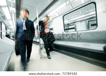 businessman in a subway, motion blur. - stock photo