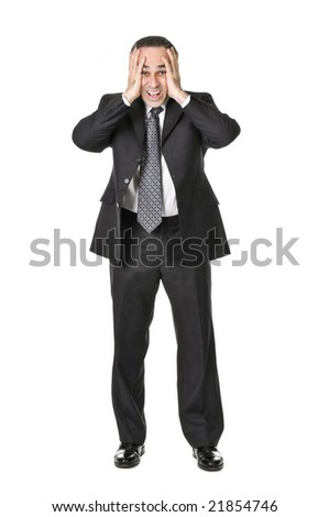 Businessman in a suit being upset isolated on white background - stock photo