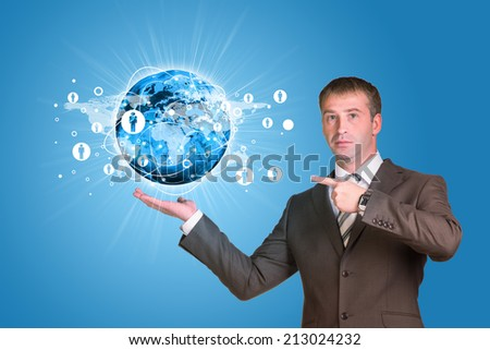 Businessman in a suit hold Earth with lines