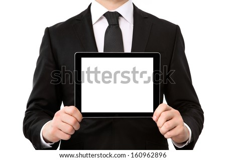 businessman in a suit holding a tablet computer with isolated screen - stock photo
