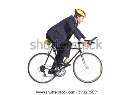 Businessman in a suit riding a bicycle - stock photo