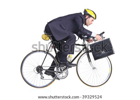 Businessman in a suit with a briefcase riding a bicycle - stock photo