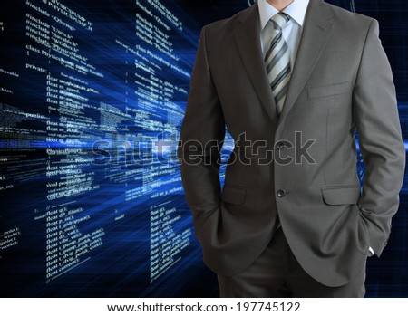 Businessman in a suit with background of glowing digital code. Business concept - stock photo