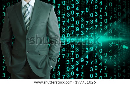 Businessman in a suit with background of green glowing figures - stock photo