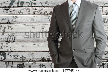 Businessman in a suit with background of various social icons on old wooden surface. Stylised frame - stock photo