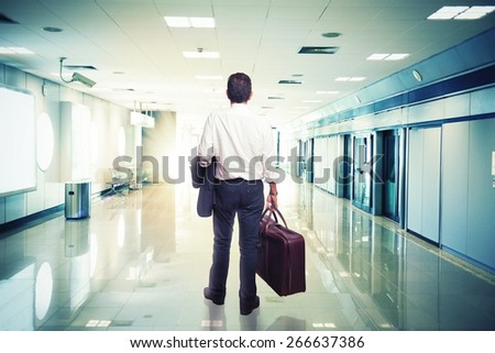 Businessman in airport ready to travel with aircraft - stock photo