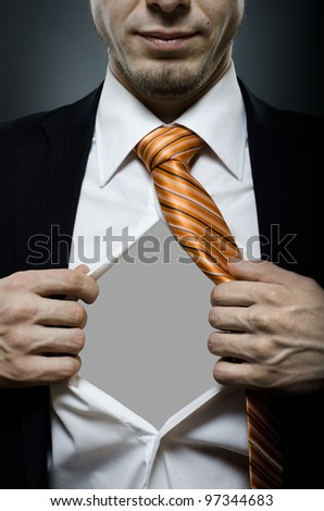 businessman  in black costume throw open one's shirt, close up