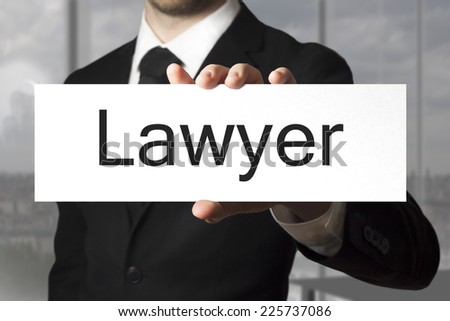 businessman in black suit holding sign lawyer - stock photo