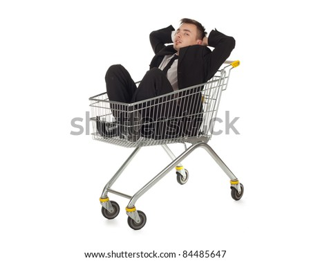 businessman in black suit in shopping cart - stock photo