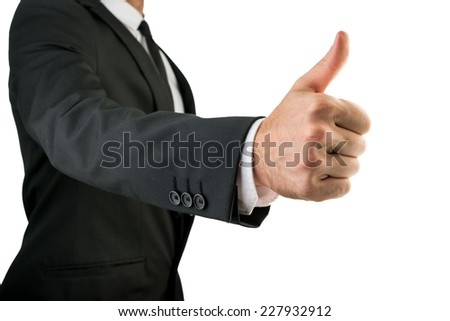 Businessman in Black Suit Showing Thumbs Up Sign, Emphasizing Approval or Satisfaction. Isolated on White Background. - stock photo
