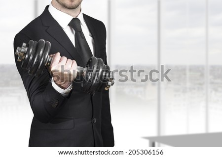 businessman in black suit wheightlifting in office