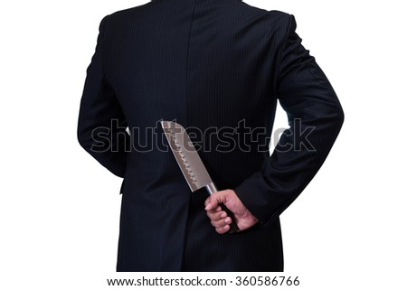 businessman in black suite hide the knife in his back isolate on white background