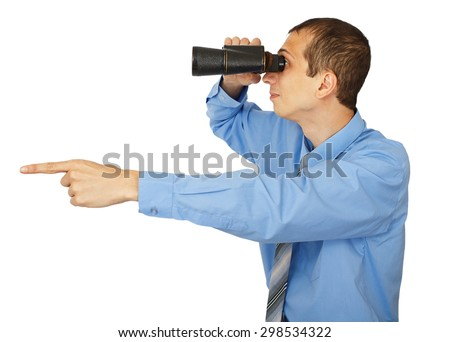 Businessman in blue shirt looking with his binocular and pointing to the copy space - stock photo