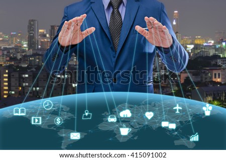 businessman in blue suite control the world , internet of things concept