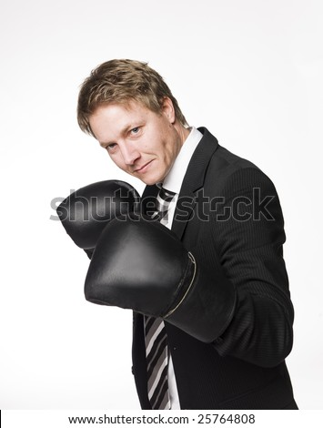 Businessman in boxing-gloves - stock photo