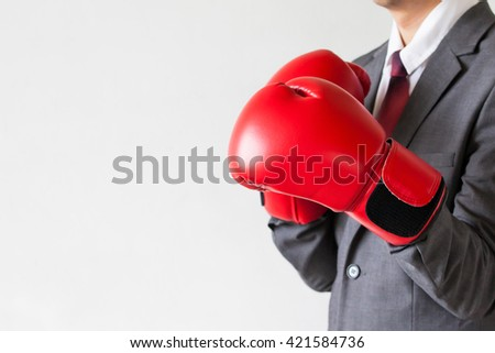 Businessman in boxing gloves guarding isolated on white background - stock photo