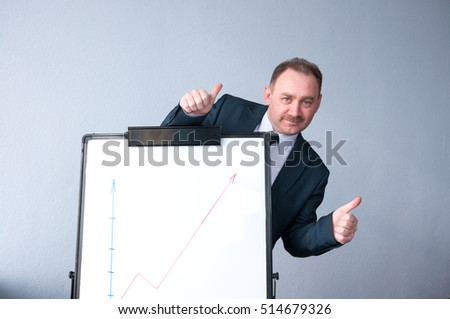 Businessman in business suit is happy sales growth