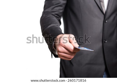 Businessman in business suit pay by credit card. - stock photo