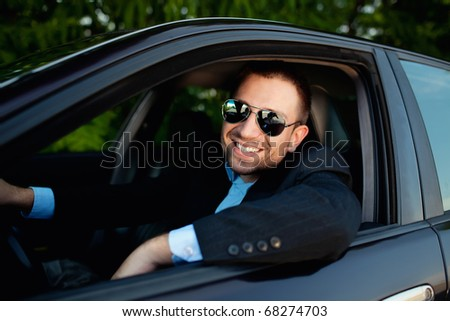 businessman in car smiling - stock photo