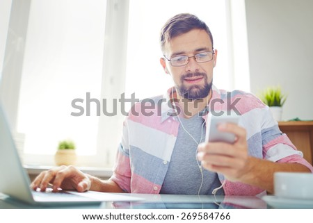 Businessman in casual using smartphone and laptop    - stock photo