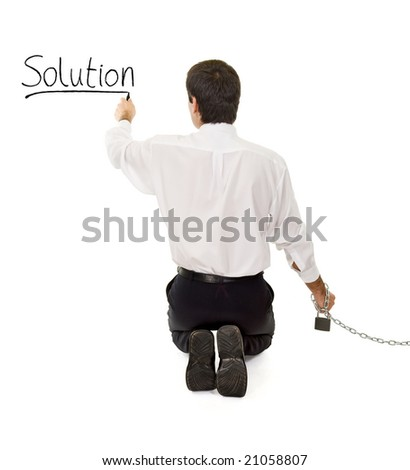 Businessman in chains searching and finding a solution - isolated - stock photo