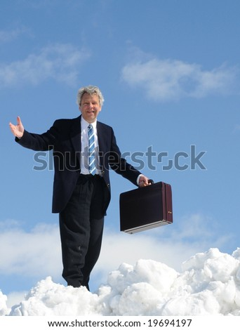 Businessman in clouds - stock photo