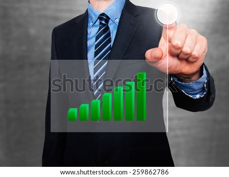 Businessman in dark suit pushing button, visual screen Growth graph going up. Grey - Stock Photo - stock photo