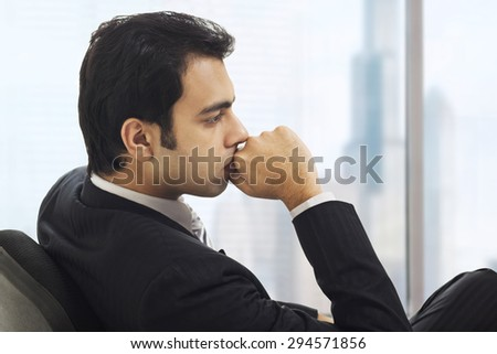 Businessman in deep thought - stock photo