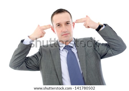 Businessman in depression - pointing with fingers on head - stock photo