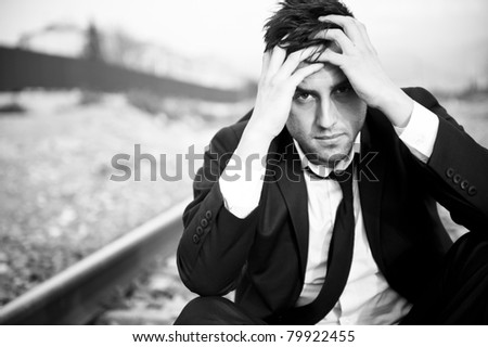 Businessman in depression with hands on forehead - stock photo