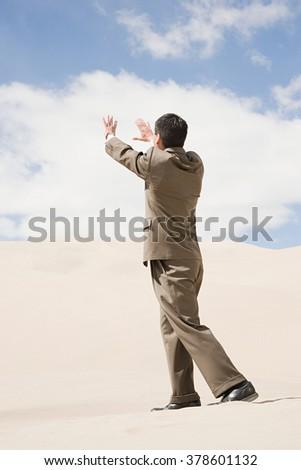Businessman in desert - stock photo