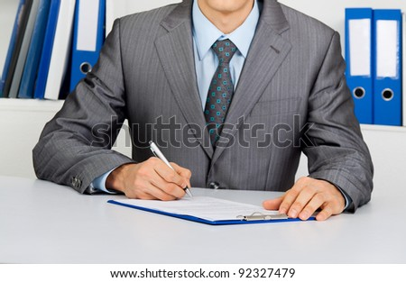 Businessman in elegant suits working with documents sign up contract, unrecognizable person sitting at the desk at office - stock photo