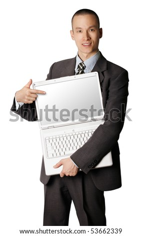 businessman in expensive suit with open laptop shows something with his finger - stock photo