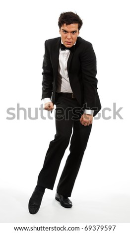 Businessman in flexible dancing pose isolated on white