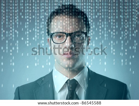 Businessman in front of a computer screen with binary code on it - stock photo