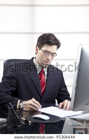 businessman in front of the computer, signing a contract - stock photo