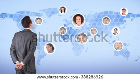 Businessman in grey suit looking against background with world map
