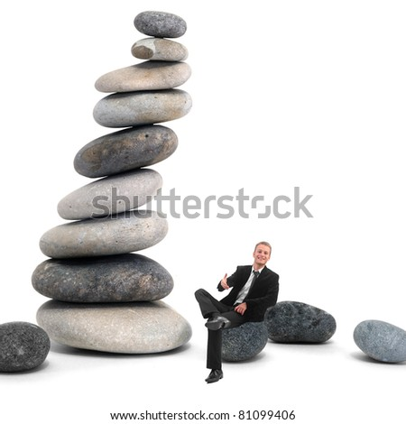 Businessman in hand shake position on a pebble composition - stock photo