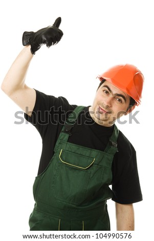 Businessman in helmet pointing up on a white background.