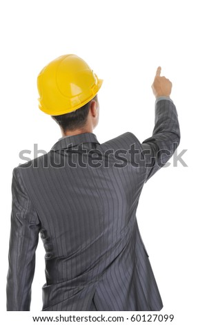 Businessman in helmet points finger up. Isolated on white background - stock photo