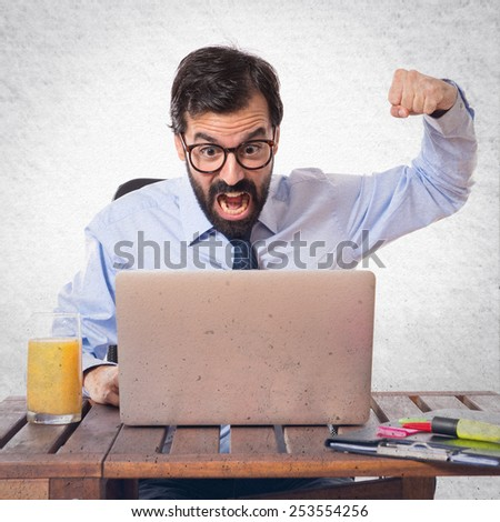 Businessman in his office giving punch over textured background   - stock photo