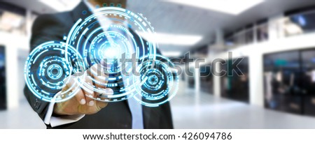 Businessman in his office pushing digital tactile circle technology screens - stock photo