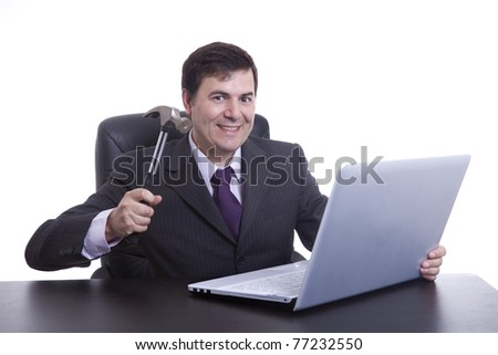 Businessman in his office threatening to destroy his PC with a hammer - stock photo