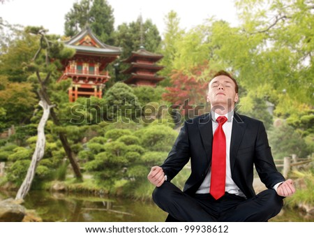 businessman in japan garden do yoga exercise - stock photo