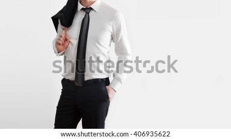 Businessman in laid-back, relaxed pose on white background. Middle body part view.